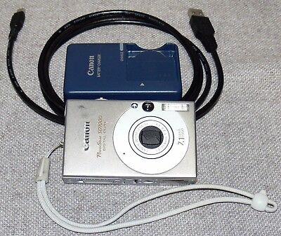 Canon PowerShot Digital ELPH SD1000 7.1MP Digital Camera, Silver, w/ Charger