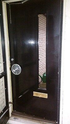 Black exterior front entry door black 70's style right-hand swing with mail slot