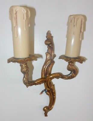 Matching Pair of Antique French rococo style gilt bronze wall lights / sconces.
