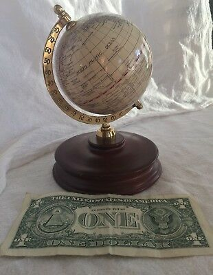 Vintage style brass world desk globe on wood stand in good condition