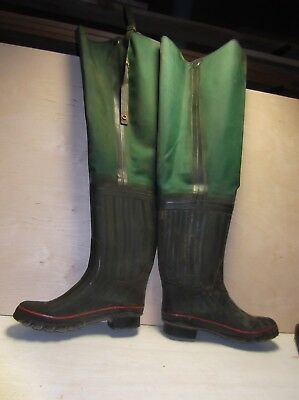 "Rubber hip boots, color green, boot size 10, 31"" tall with belt strap"