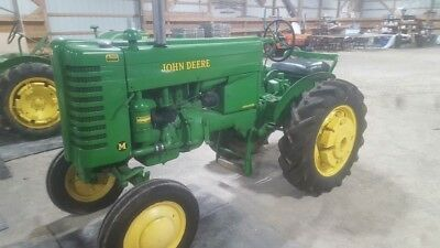 1950 John Deere M tractor runs good. No reserve bid to win