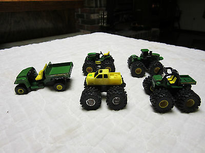 SeeJOHN DEERE LOT OF 5  TOYS 4 MINIS W/MONSTER TIRES AND 1 ATV CART