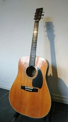 six string acoustic guitar made by Hohner sounds great and needs a new home