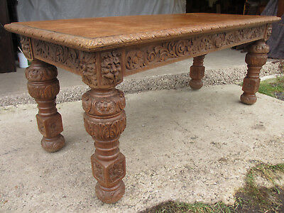 Victorian carved heavy oak dining table with lion heads and floral frieze (526)
