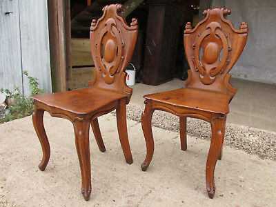 Pair victorian carved golden oak shield back side/hall chairs cabriole legs (527