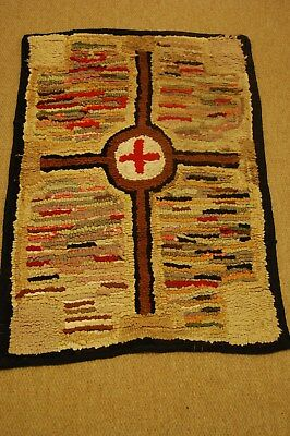 Antique traditional Latch-hooked Rag rug with cross design in bright colours.