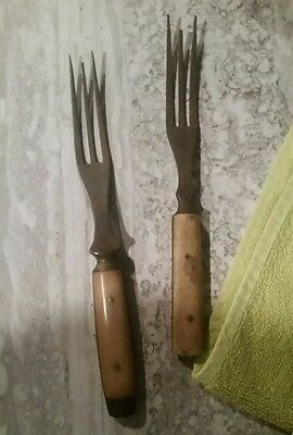 two antique forks