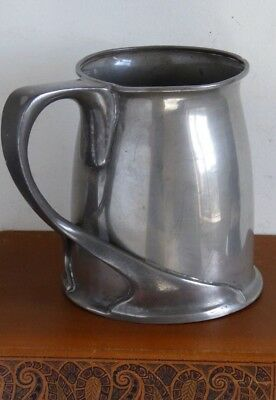 Liberty & Co, Archibald Knox early pewter tankard stamped 'TUDRIC 066'.