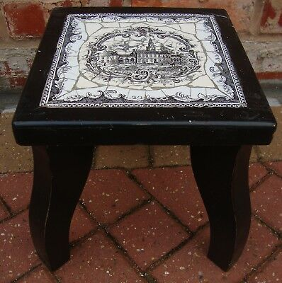 Old Wooden Stool With An Antique Tile