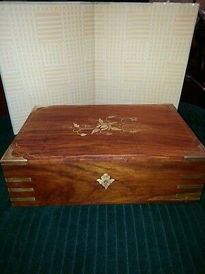 Old vintage wooden jewelry box with brass and copper inlay