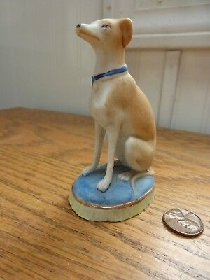 Vintage porcelain dog figurine sitting on pillow Greyhound or Whippet animal