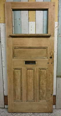 AN EDWARDIAN VENEERED OAK ON PINE FRONT DOOR WITH PANEL FOR GLAZING  ref 972