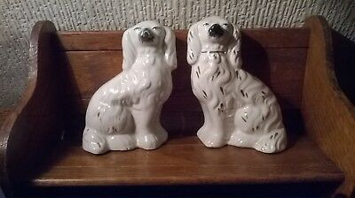 2 X VINTAGE WHITE SPANIELS  STAFFORDSHIRE WARE, ENGLAND. APPROX.6 1/ 2ins. TALL.
