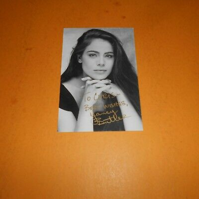 Yancy  Butler is an American actress Hand Signed Photo