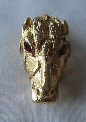 Vintage gold tone horse head brooch and scarf clip with red rhinestones