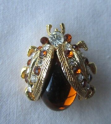 Vintage gold tone bug brooch with brown rhinestones