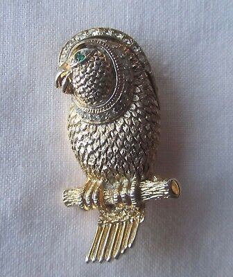 Vintage gold tone parrot brooch with rhinestones