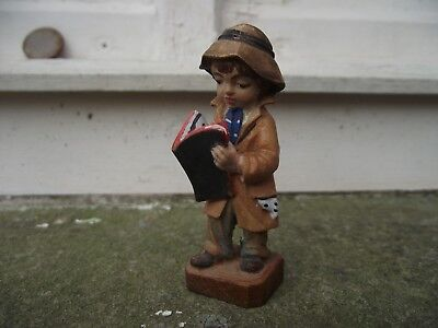 Vintage hand carved & painted wooden figurine figure of boy reading newspaper