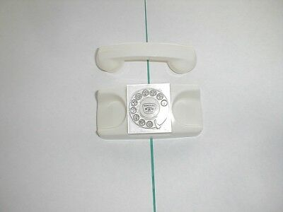 GTE Automatic Electric White Telephone Salesman Sample paperweight