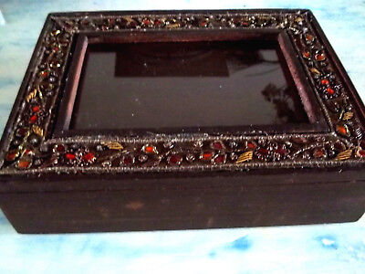 Vintage wooden jewelry box with a photo frame and jeweled decoration on the lid