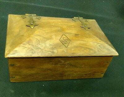 Vintage wooden box with brass ornate hinges and makers mark on li did