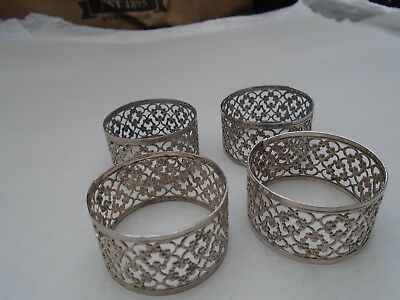 set of 4 delicate white metal napkin rings with lovely ornate design TAKE A LOOK