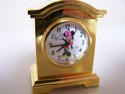 Tiny Clock features Minnie Mouse by Disney
