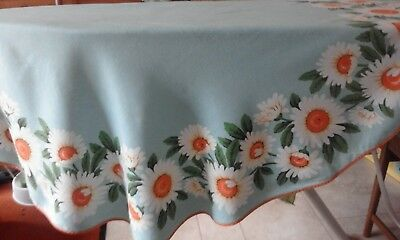 vintage tablecloth circular turquoise with daisy pattern. Good condition