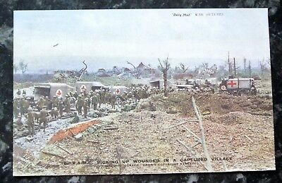 WWI Daily Mail pc, RAMC picking up wounded in captured village