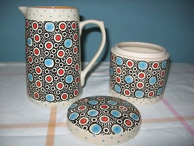 Pretty jug and matching jar with lid