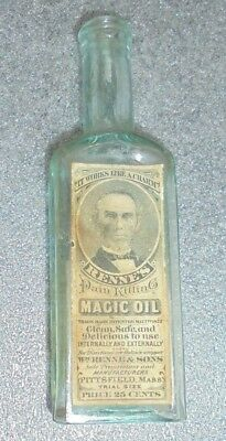 old aqua glass bottle Renne's pain killing Magic Oil with graphic label