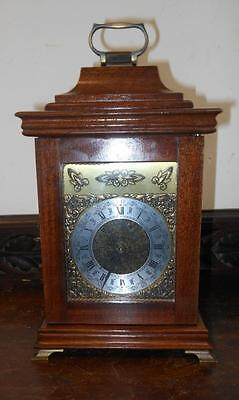 pretty small  walnut cased striking  ting tang bracket clock