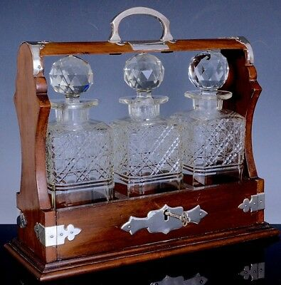 V.FINE ANTIQUE SOLID WOOD & SILVER PLATE TANTALUS w 3 CUT GLASS LIQUOR DECANTERS