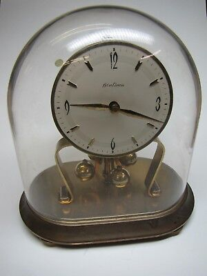 An Oval 400 day Anniversary Clock with Dome