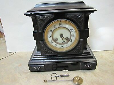 An 8 day French Striking Mantel Clock in a Wooden Case