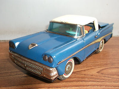 Old vintage battery powered convertible ford tin toy car of 50's, made in Japan.