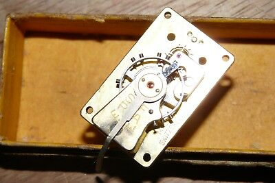 Clock Jewelled balance wheel assembly. In London jewellers box.Carriage clock?