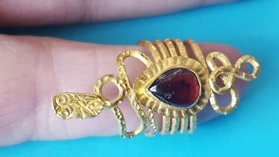 Egyptian super rare gold snak/serpent ring with centre garnet. 30 BC to 323 CE.