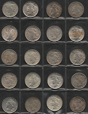*$ 20 US coins Silver Peace dollars on page, mixed condition