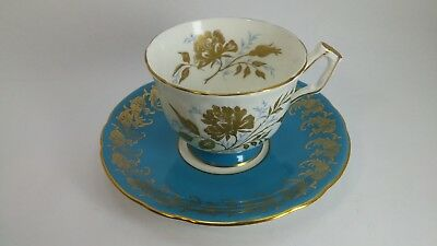 AYNSLEY TURQUOISE BLUE TEXTURED GOLD FLORAL TEACUP AND SAUCER Gold Gilt