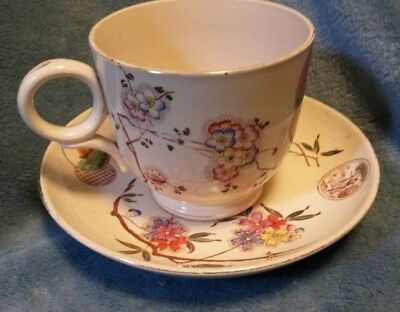"""4"""" tall cup and 8"""" off white round saucer set with flowers and pictures on them"""