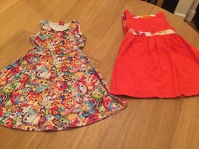 2 dresses - one reversible and one shopkins age 4/5 years