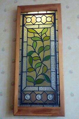 Four framed vintage stained glass window panels