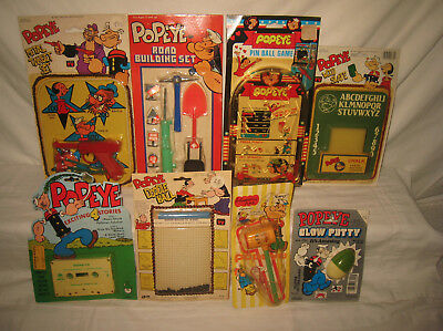 Lot of Eight Assorted Vintage Popeye Toys, Games, Etc All Mint On Cards MQ9