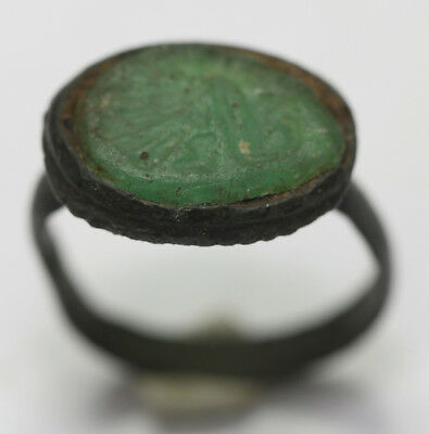 medieval bronze finger ring with green glass pattern inside of northern Europe.
