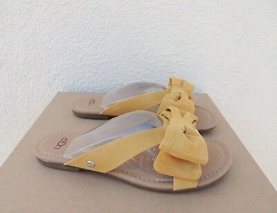 fdef2bdaa4c UGG FONDA SUNFLOWER Yellow Suede Bow Slide Sandals
