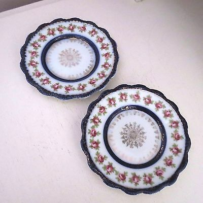 Two sweet little flow blue porcelain plates with pink roses