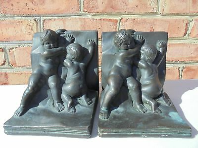 Old Antique Bronze Clad Bookends Babies or Cherubs Pushing