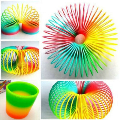 Colorful Rainbow Kids Magic Slinky Glow-in-the-dark Spring Children Party Toy D2